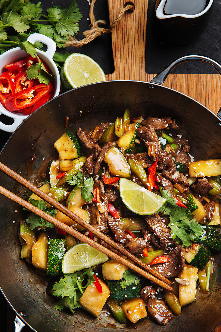 Ooriental spicy stir fry meat with zucchini and red pepper