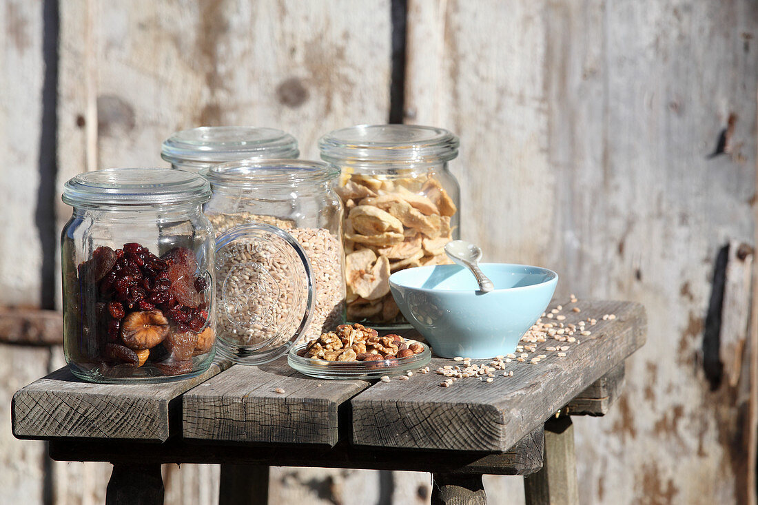 Dried fruits, grains and nuts in storage jars