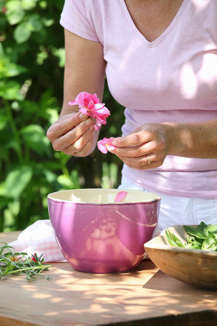 A woman plucking rose petals