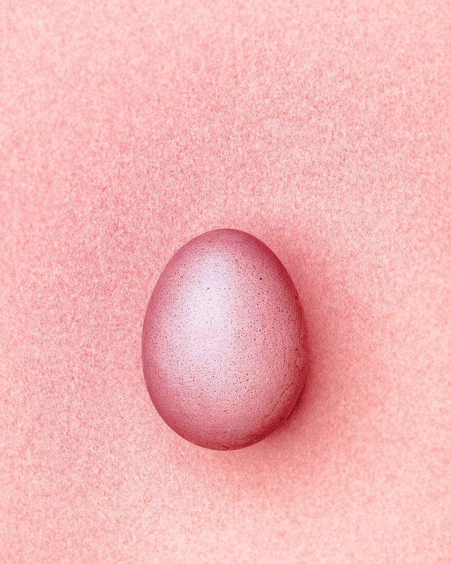Pink Easter egg on a pink background