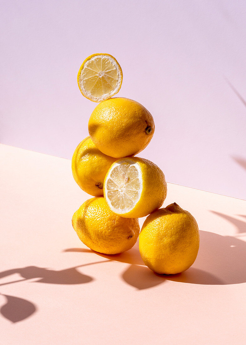 Fresh lemons stacked in shape of pyramid