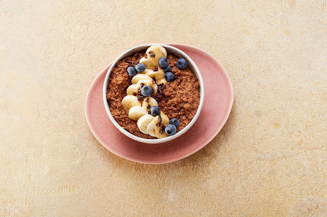 Vegan cocoa porridge with blueberries
