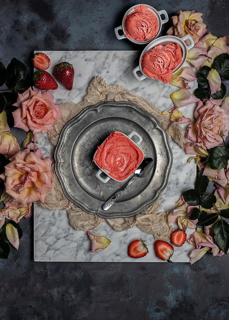 Homemade strawberry sorbet, fresh berries and rose flowers