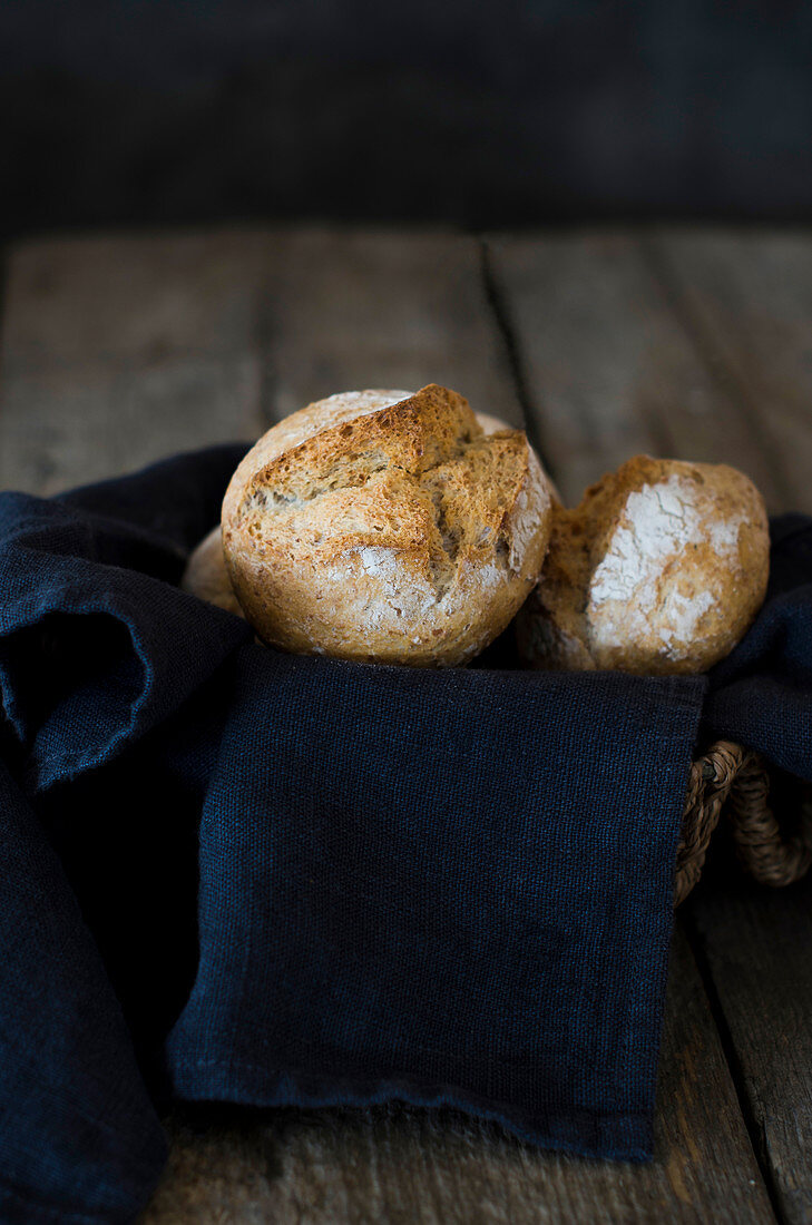 Freshly baked bread rolls with napkin