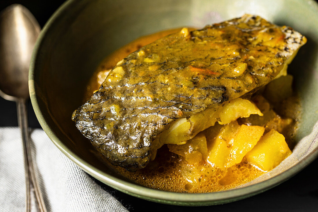 Fish with stewed potatoes and saffron