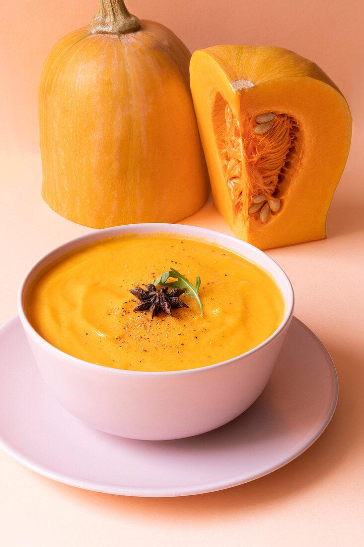 Pumpkin cream soup and fresh raw pumpkin