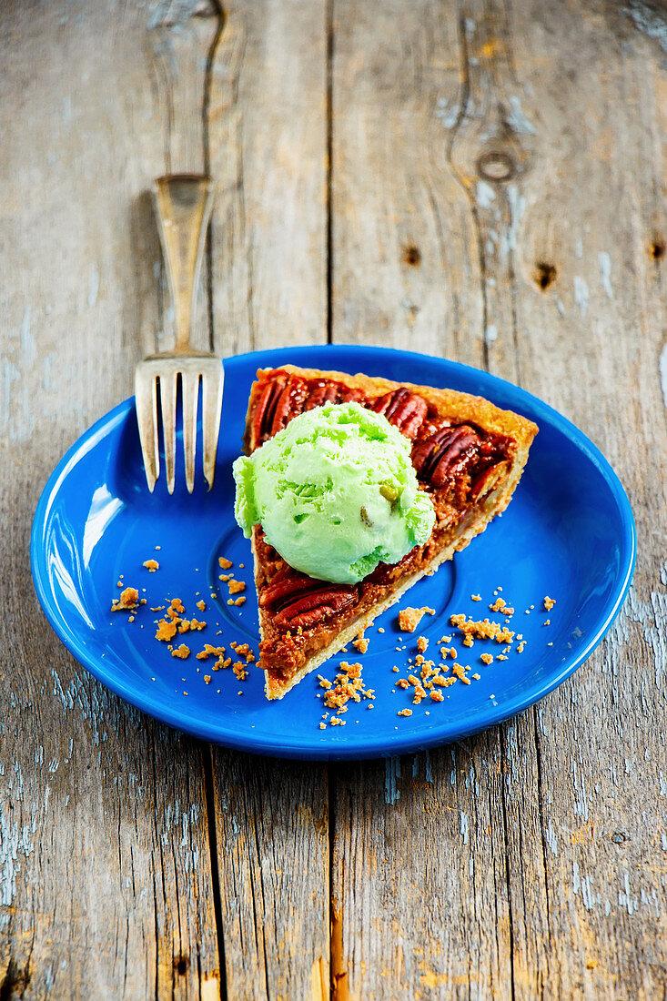 Slice of pecan nut tart with pistachio ice cream