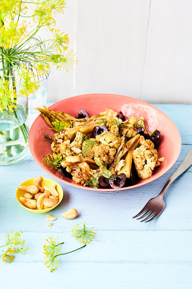 Indian cauliflower salad with cashew nuts and cherries