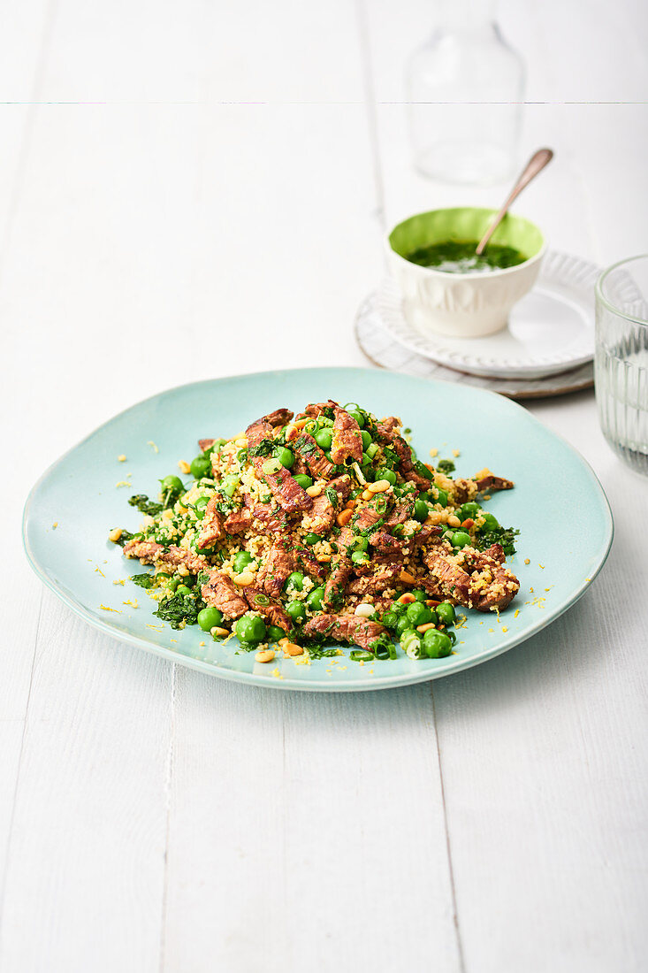Couscous with pork gyros, peas and spinach