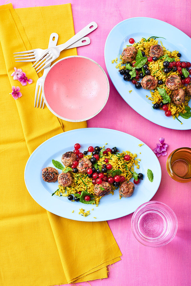 Indian rice salad with meatballs and currants