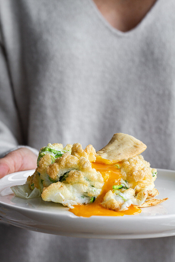 Cloud eggs with green vegetables and crackers for breakfast