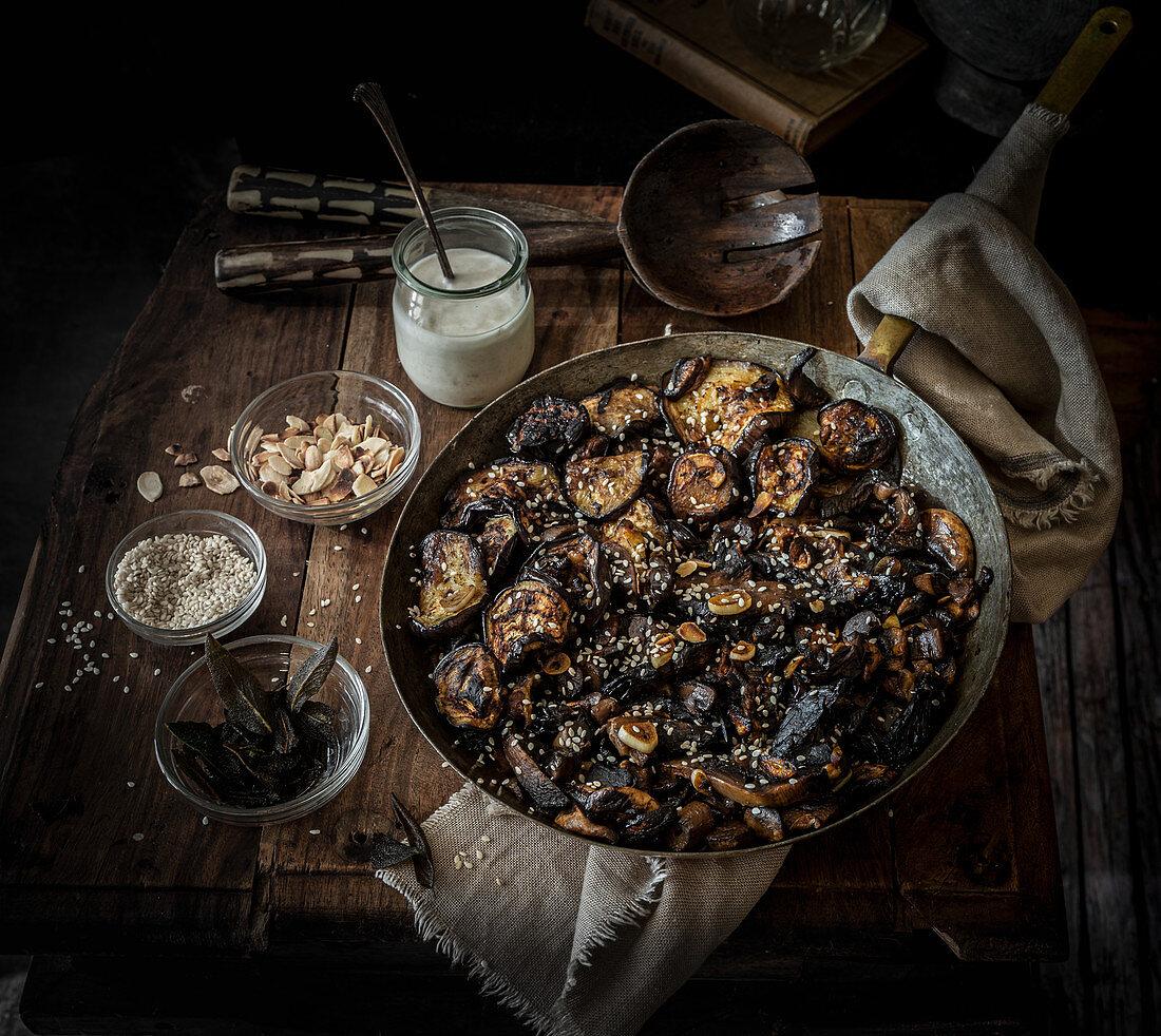 Aubergine Mushroom savoury umami dish with garlic and sesame seeds and tahini dressing