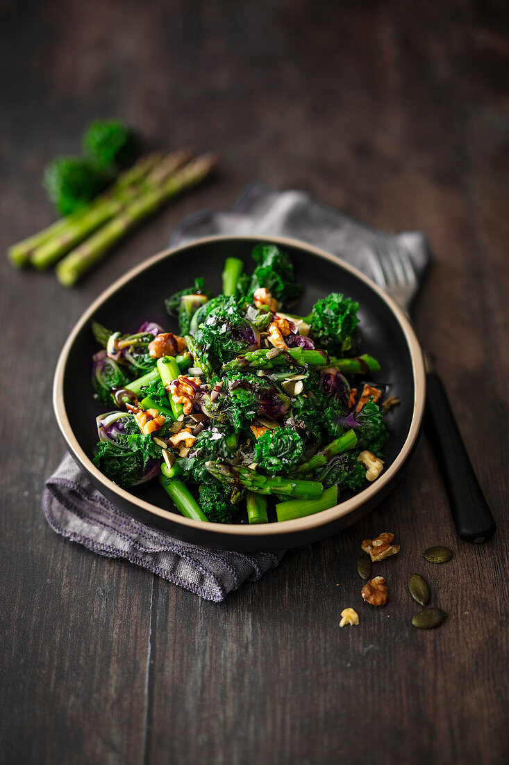Flower sprouts (cabbage saplings) with green asparagus and walnuts