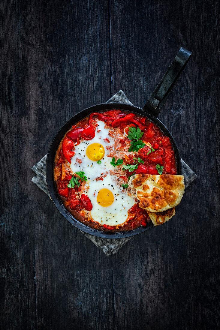 Shakshuka with naan flatbread and eggs (vegetarian)