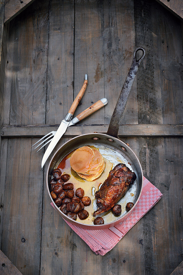 Leg of beaver with caramelised chestnuts, pancakes and maple syrup
