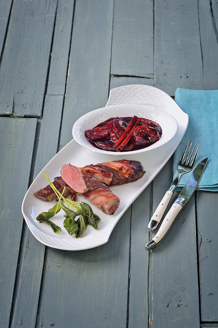 Wild hare fillets wrapped in bacon with balsamic damsons