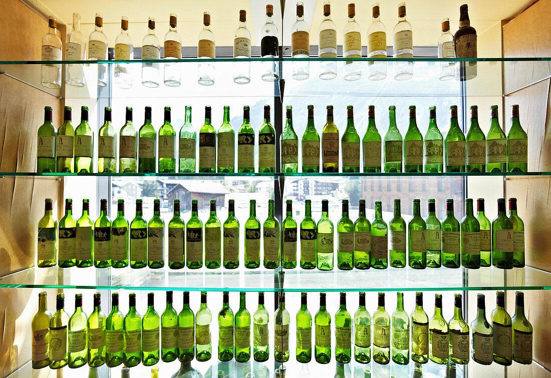 Empty wine bottles in a cabinet, Lech, Arlberg, Austria