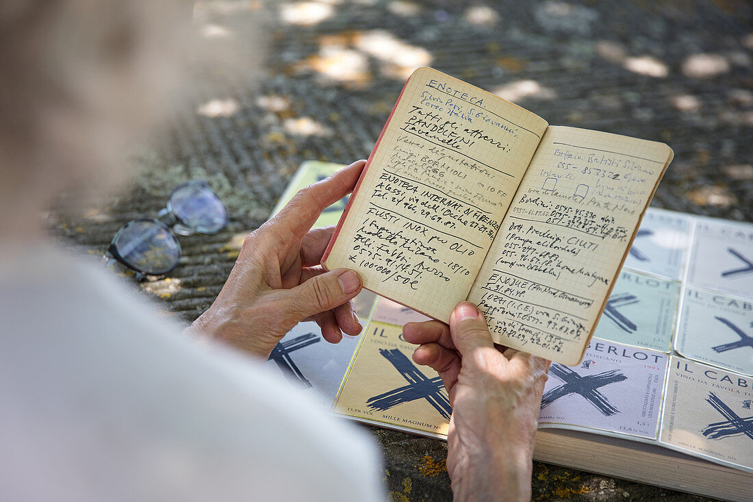 A person holding a notebook, Caberlot, Carnasciale, Tuscany, Italy