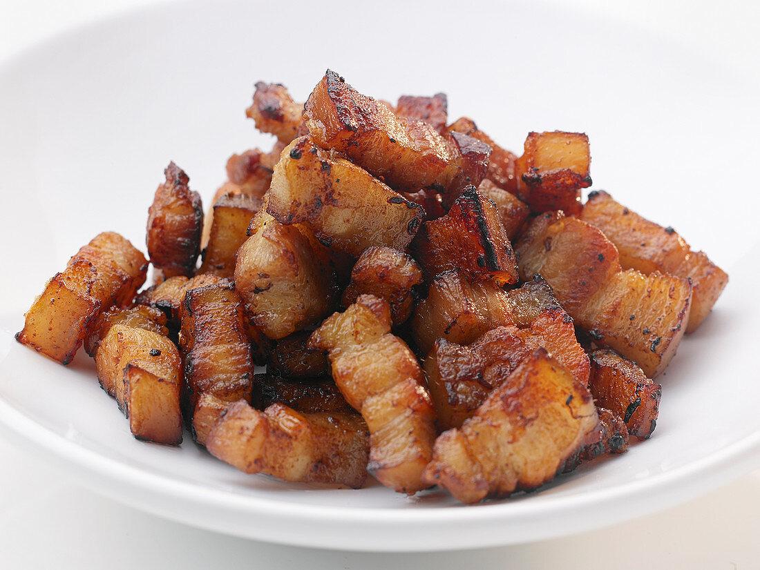 Strips of roasted pork belly