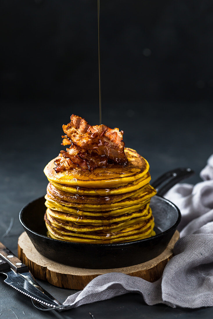 Spicy sweet potato pancakes with bacon and maple syrup