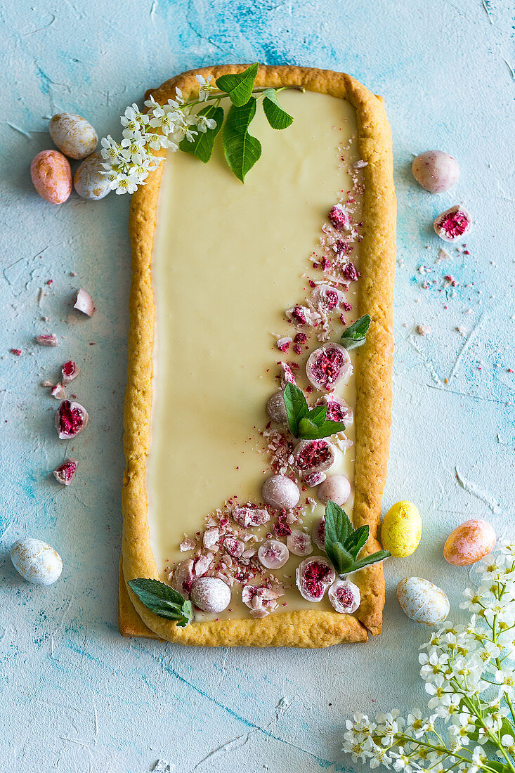 Easter cake decorated with crumbled confectionery eggs