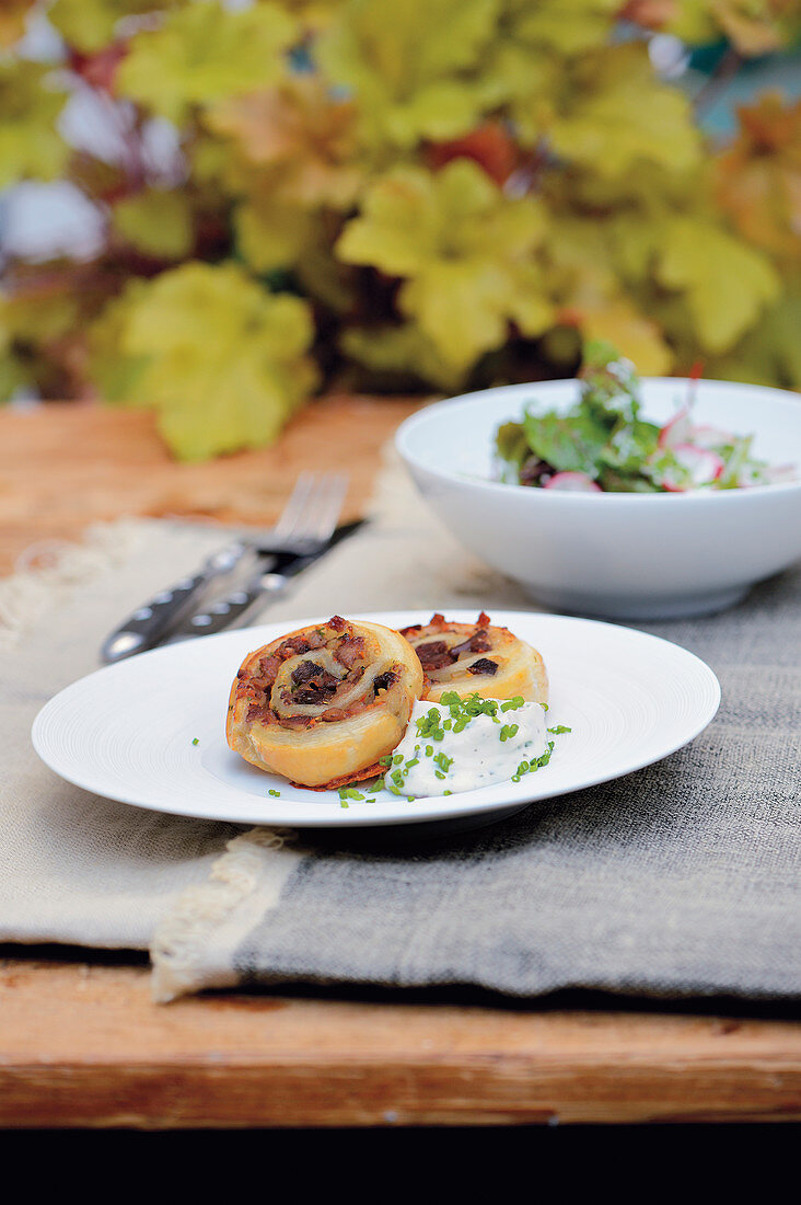 Puff pastry snail with wild boar head