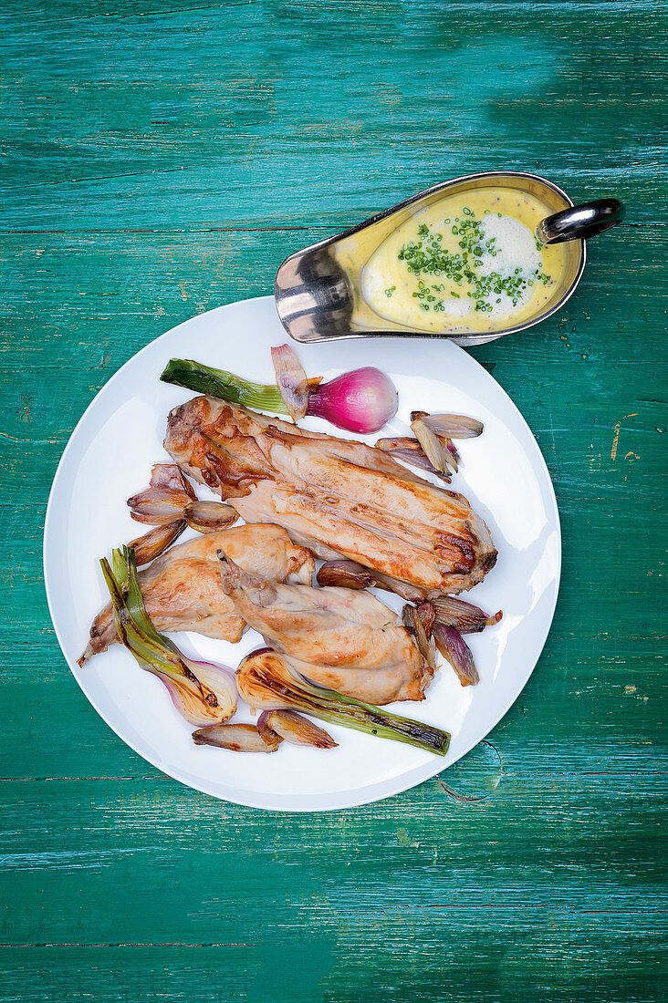 Rabbit with pommery-mustard sauce and spring onions