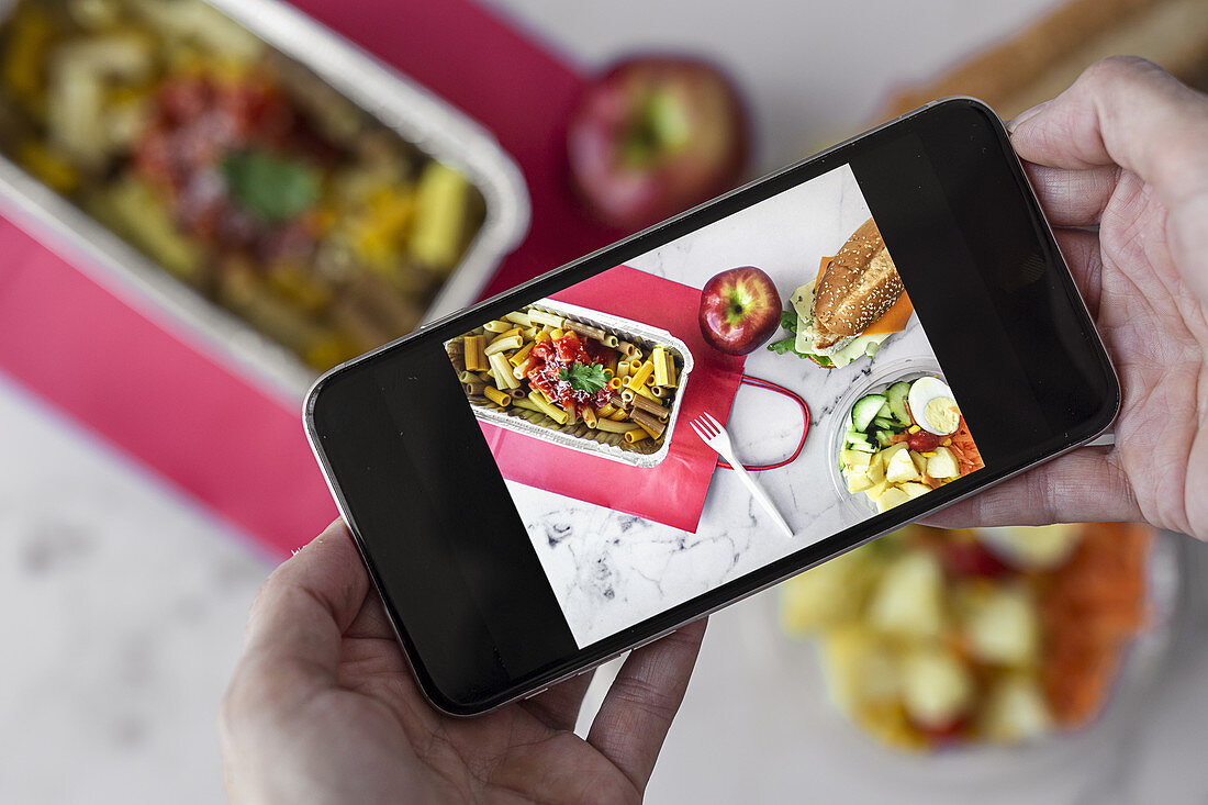 Taking picture of takeaway food with smartphone