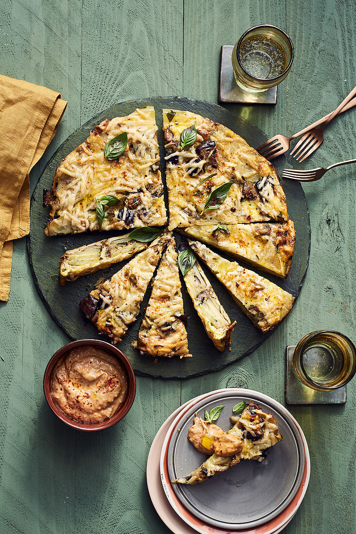 A potato tortilla with aubergines and an olive and tomato mayonnaise