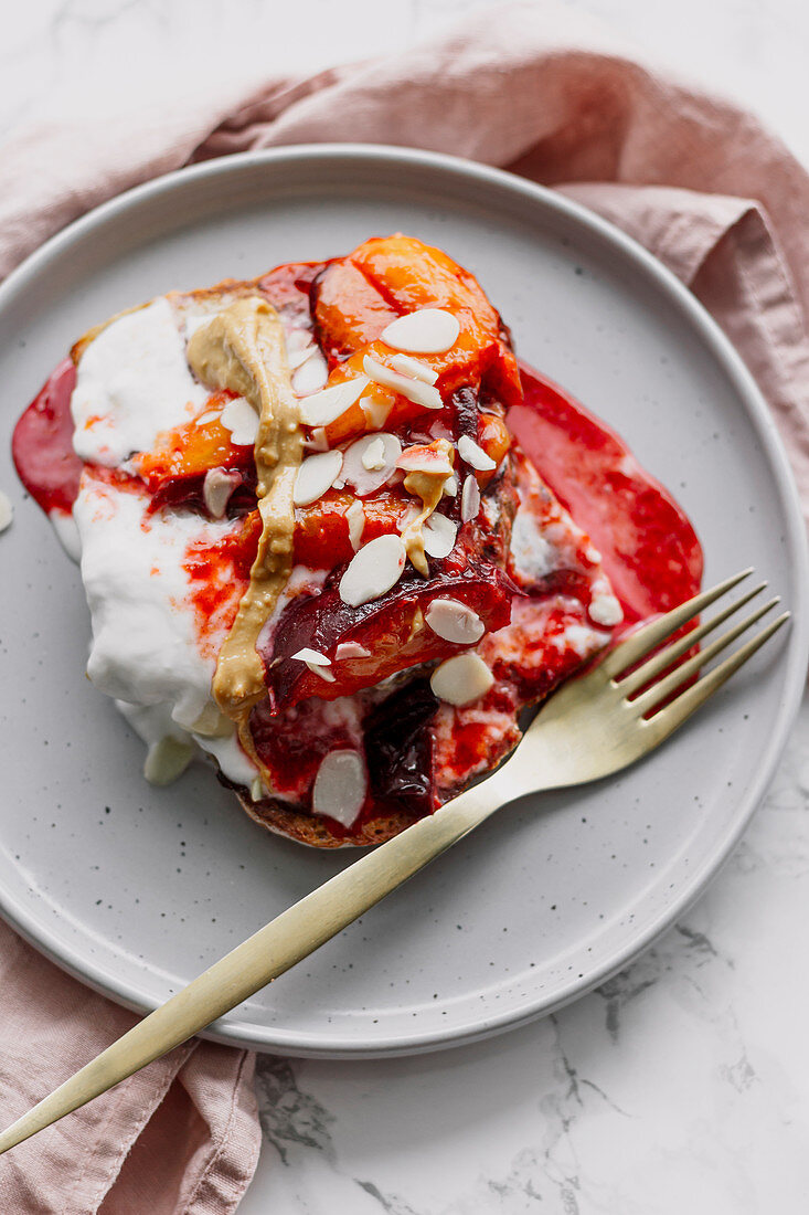 French toast with plums, yoghurt, peanut butter and almonds