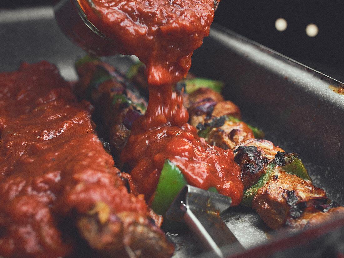 Grilled sashlik with sauce