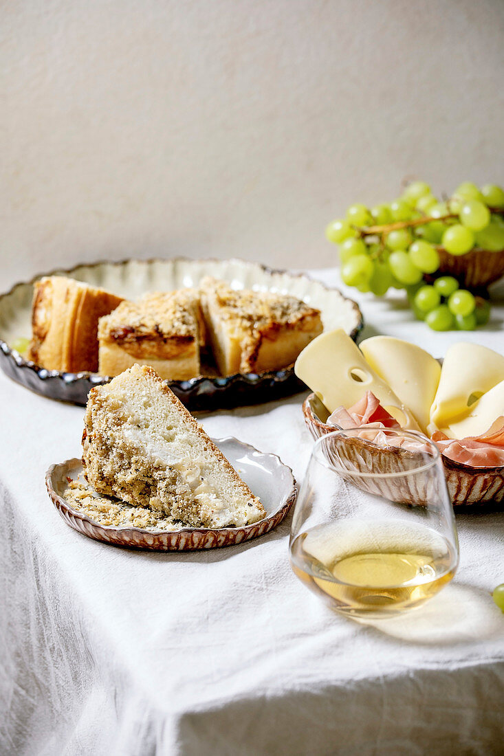 Antipasti with white sicilian focaccia, prosciutto, cheese and grapes