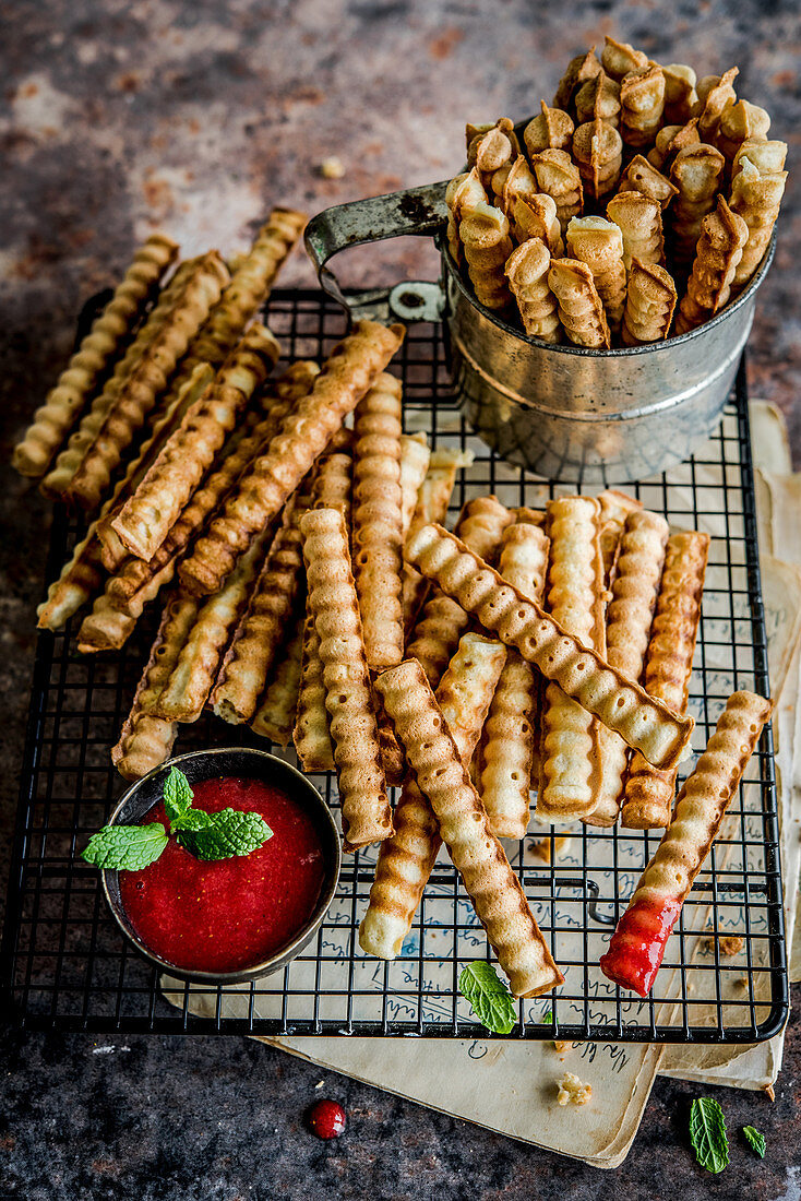 French fries shaped waffles with strawberry sauce