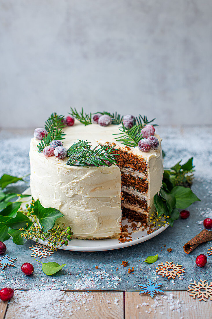 Ginger cake layred with vanila mascarpone cheese icing decorated for Christmas