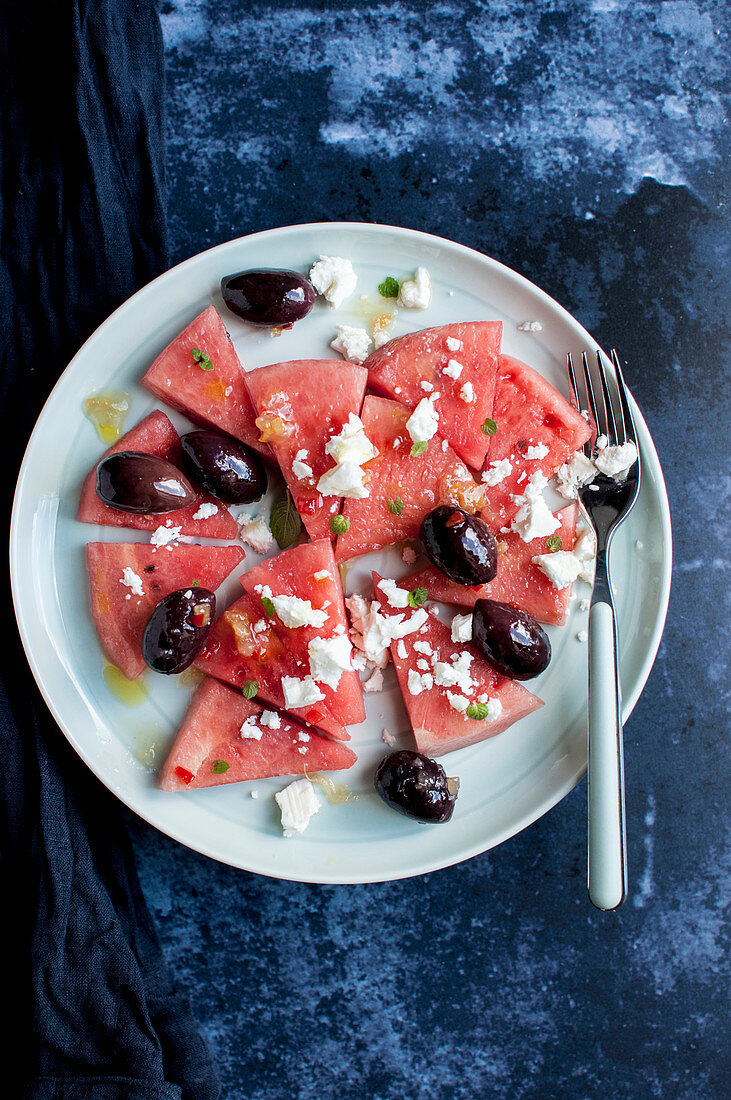 Watermelon salad with black olives, feta cheese, fresh mint and preserved lemon