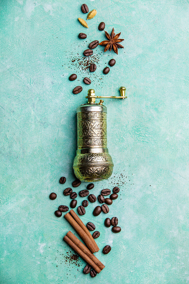 Vintage manual coffee grinder, coffee beans and spices