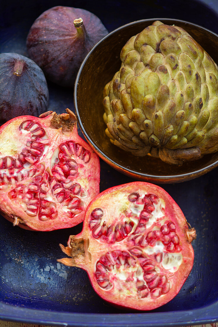 Custard apple fruit, chopped pomegranates and two figs