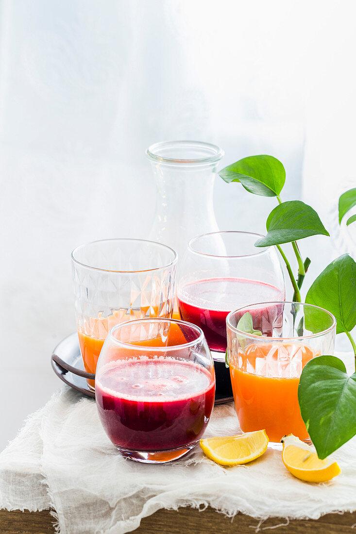 Beet Carrot Apple Juice an Orange Carrot Ginger Juice in glasses