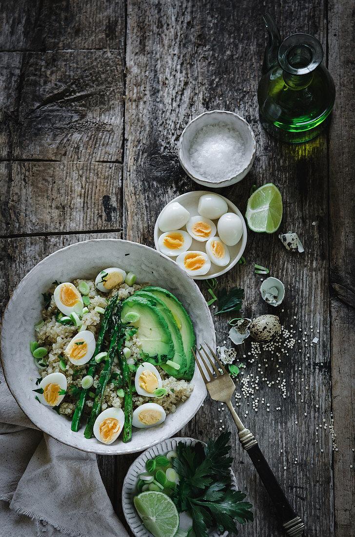 Quinoa salad with avocado, quail eggs and asparagus