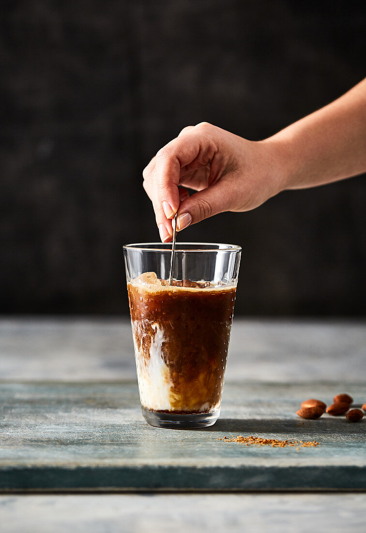 Stirring cold brew coffee