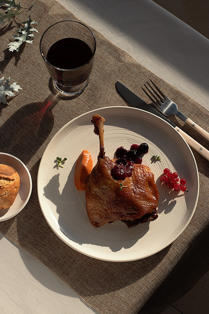 Fried duck confit on white ceramic plate