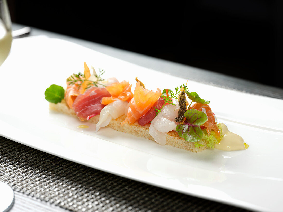 Fish carpaccio with herbs on crouton