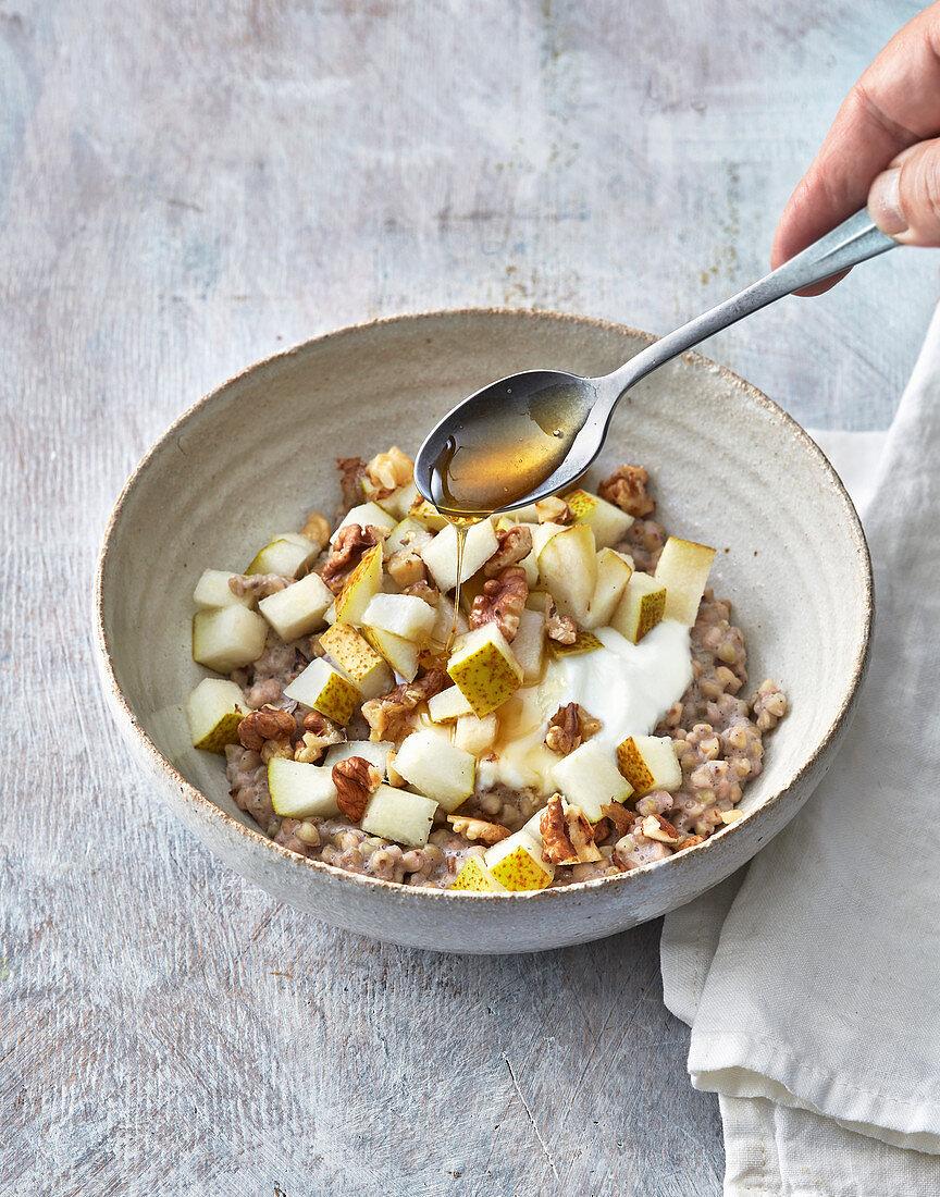 Nutty buckwheat porridge with sheep's yoghurt, pear and maple syrup