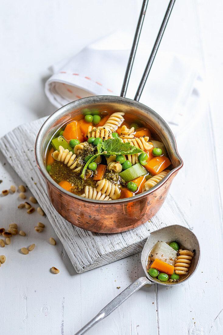 Spring vegetable stew with noodles and kohlrabi pesto