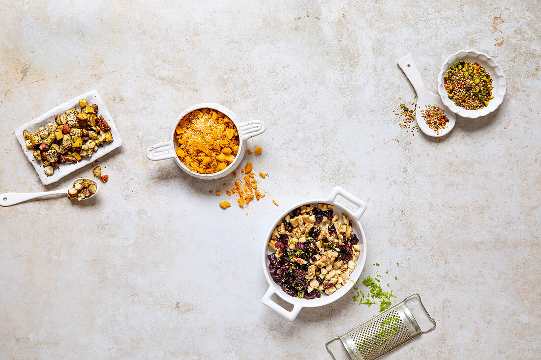 Four dishes with different nut toppings