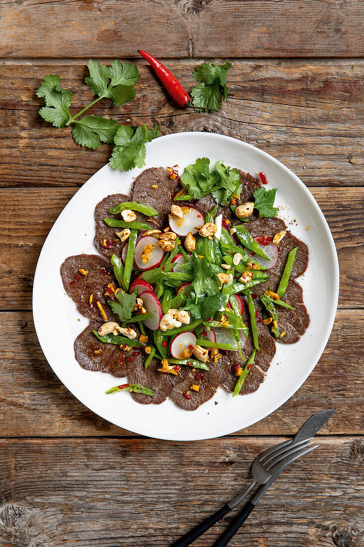 Marinated fillet of beef with salad