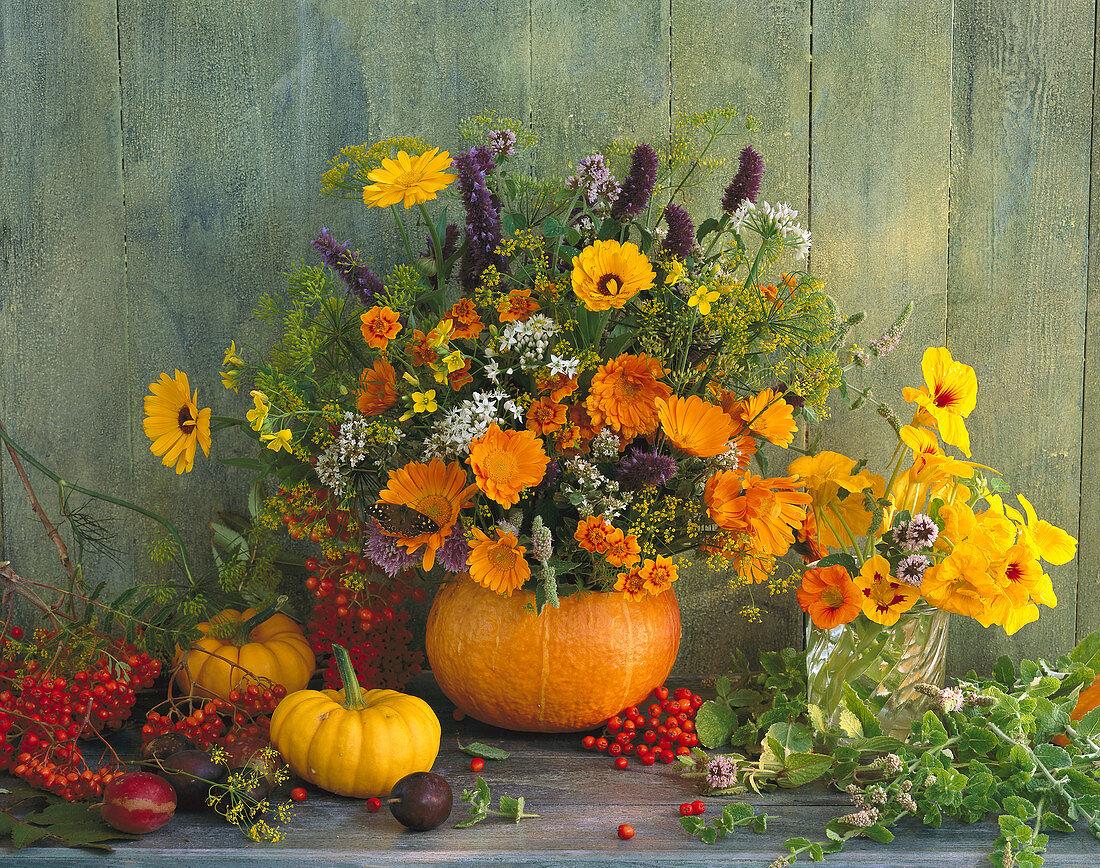 Bouquet of marigold, hyssops, nasturtium, fennel, marigolds and rowan berries