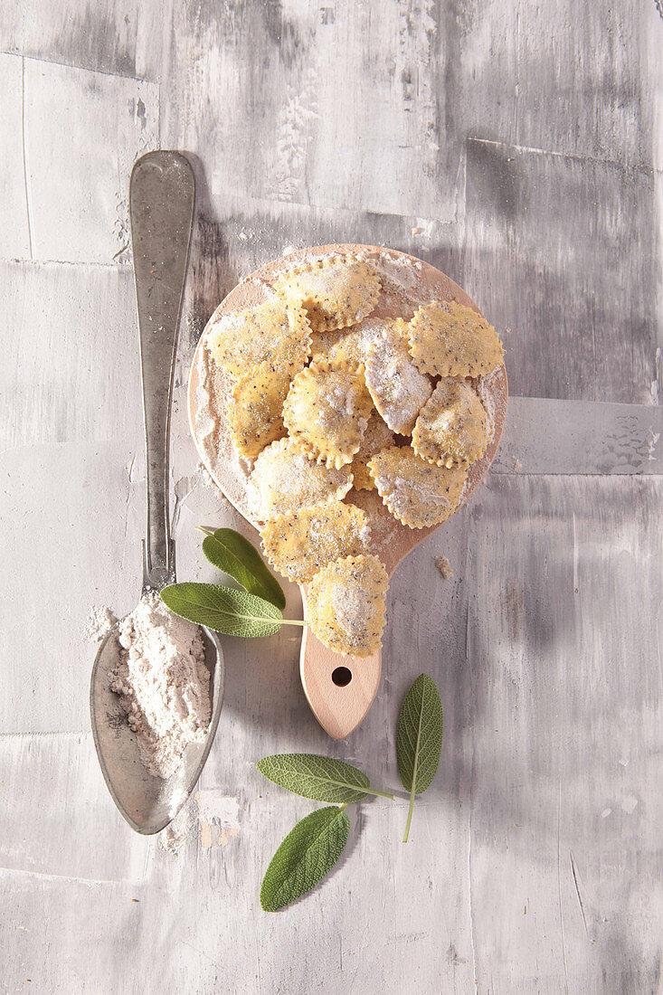 Fresh uncooked sage ravioli