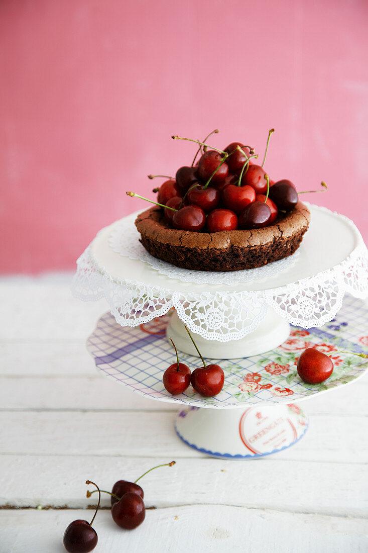 Mini chocolate cake with fresh cherries