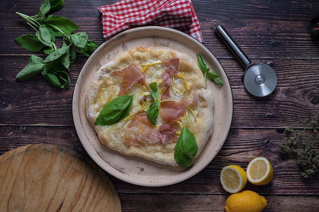 Pizza al Limone with Parma ham and mozzarella cheese